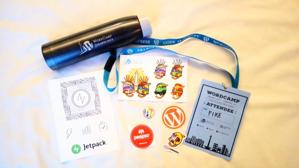 WordCamp swag spread out on a surface.